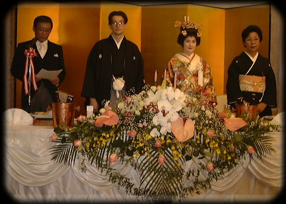 Mr. & Mrs. Sasaki and ZnL in front of the gold screen